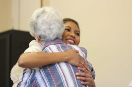 A sister greets and congratulates Sister Jessica after the ceremony.