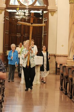 The entrance procession led by Sister Jenny Howard carrying the cross.