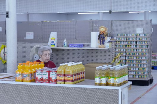 Sister Mary Lois Hennel staffs the juice area.