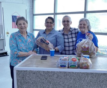 """""""Breaking bread"""" takes on new meaning at the pantry. From left, Sisters Ann Sullivan, Joni Luna, Barb Battista and volunteer Vicki Dickinson."""