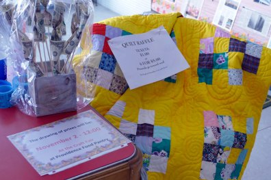A beautiful quilt is part of the raffle treasure.