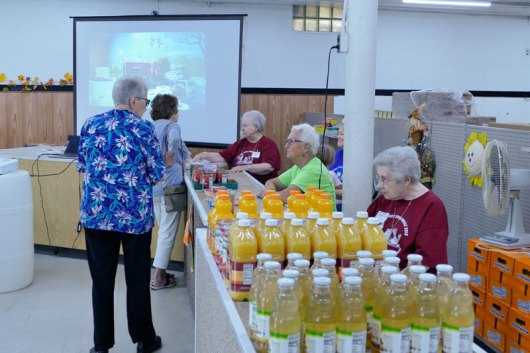 As volunteers and sisters staffed locations, a slide show of the pantry's history ran in the background.
