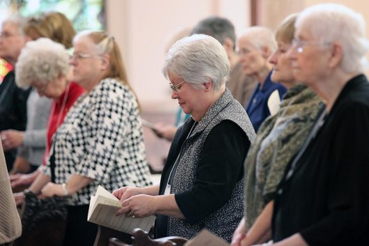 New Providence Associate Kathy Sternal prays during the liturgy