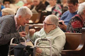 Providence Associate Sheila Galvin visits with Sister Rose Virginia Eichman before mass