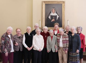 The Sisters of Providence of Saint Mary-of-the-Woods, Indiana, honored their 70-year Jubilarians on Tuesday, Dec. 17, including (front, from left) Sister Charles Van Hoy, (front, third from left) Sister Margaret Norris, Sister Regina Marie McIntyre, Sister Joann Quinkert, Sister Rosemary Eyler, Sister Suzanne Buthod and Sister Barbara Ann Bluntzer. They are photographed with (front, second from left) General Councilor Sister Mary Beth Klingel, (back, from left) General Councilor Sister Lisa Stallings, General Superior Sister Dawn Tomaszewski and General Councilors Sister Jenny Howard and Sister Jeanne Hagelskamp. Not photographed: Sisters Marian Brady and Marie Denis Lucey.
