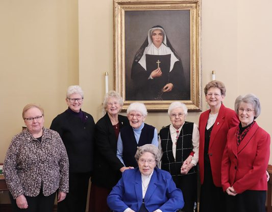 The Sisters of Providence of Saint Mary-of-the-Woods, Indiana, honored their 75-year Jubilarians on Tuesday, Dec. 17, including (front) Sister Miriam Clare Stoll and (back, third and fourth from left) Sister Florence Norton and Sister Mildred Giesler. They are photographed with (back, from left) General Councilors Sister Mary Beth Klingel, Sister Lisa Stallings, Sister Jenny Howard, General Superior Sister Dawn Tomaszewski and General Councilor Sister Jeanne Hagelskamp. Not photographed: Sister Rita Clare Gerardot.
