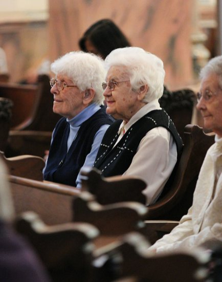 Sister Florence Norton and Mildred Geisler smile while listening to the reflection