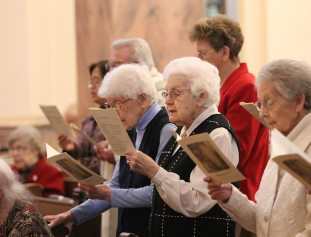 Sister Mildred Geisler joins the sisters in song