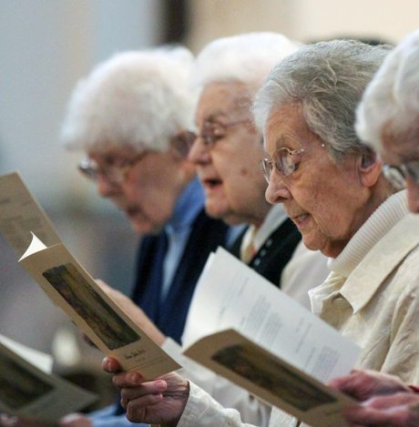 Sister Regina Marie McIntyre joins the other sisters in song