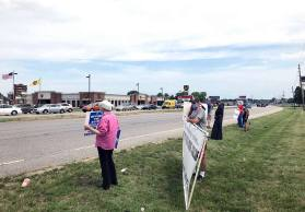 Sister Nancy Bartasavich, left, joins the group of the peaceful anti-death penalty protesters along US 41 in Terre Haute on Wednesday
