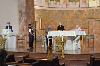 Blessing of the ring: from left Sisters Corbin Hannah, Mary Beth Klingel, Jenny Howard and Fr. Dan Hopcus