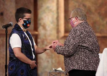 Sister Corbin Hannah receives the ring symbolizing her full committment from Sister Mary Beth Klingel.