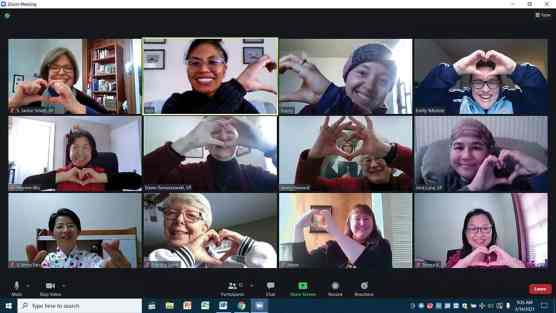 Sisters in formation and the new membership team show some love during a Zoom gathering.