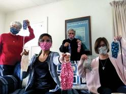 Sisters living in the formation house, from left, Sisters Marsha Speth, Jessica Vitente, Nancy Bartasavich and Janice Smith, show off the masks they have made.