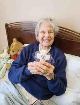 Sister Jackie Hoffman with her cookie celebrating 70 years as a Sister of Providence in December. She died of COVID-19 in January.