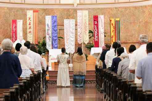 Sisters Jessica and Joni stand before the Providence banners as they prepare to exit the church.