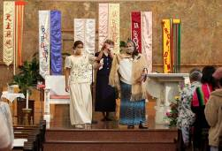 Sisters Jessica and Joni raise their hands to applause after the vows.