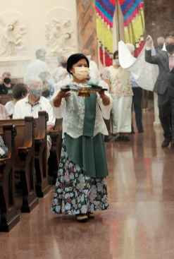 Sister Editha Ben carries in incense.