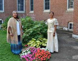 Sister Joni Luna, left, and Sister Jessica Vitente, right, on the day of their vows. Both dressed according to their cultural heritage, Sister Joni's Native American and Sister Jessica's Filipino.
