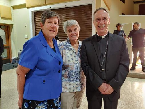 Sister Betty Paul (left) and Sister Kathy French with Bishop Luis Zarama, Bishop of Raleigh.
