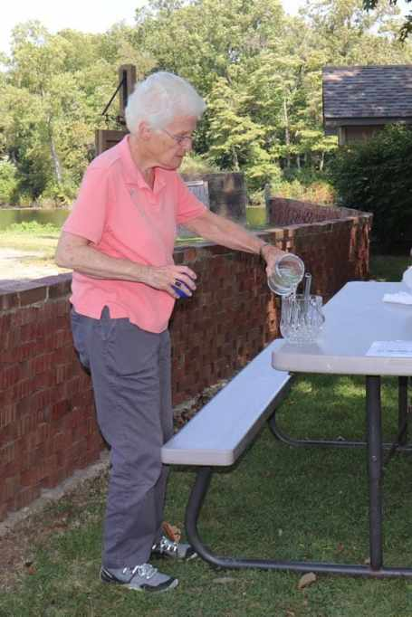 Sister Jean Fuqua, SP, mixing St. Joseph's lake water with holy water for the blessing.