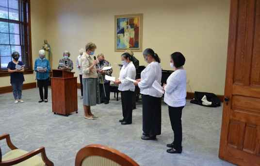 General Superior Sister Dawn Tomaszewski leads the entrance ceremony for Leslie, presented by new membership director Sister Joni Luna and her discernment guide Sister My Huong Pham