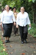 Sister Joni Luna and Leslie Dao walk to Providence Hall for the knocking ceremony