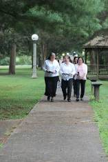 Sister Joni Luna, Leslie Dao and Sister My Huong Pham enjoy each other's company as they walk from prayer to the ceremony