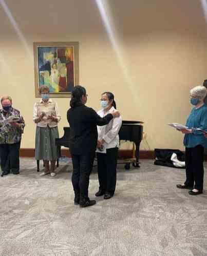 Sister Teresa Kang blesses Leslie