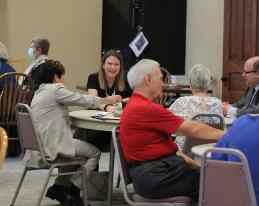 Providence Associate Erin Gick visits with those at her table during lunch.