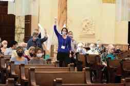 Providence Associates Jonnee Western and Mary Beth Tribble lead the group brining up the altar cloth.