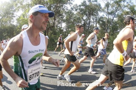 Tony Banfield comepting recently in the Mt Coottha MousDash sporting an impressive Mo!