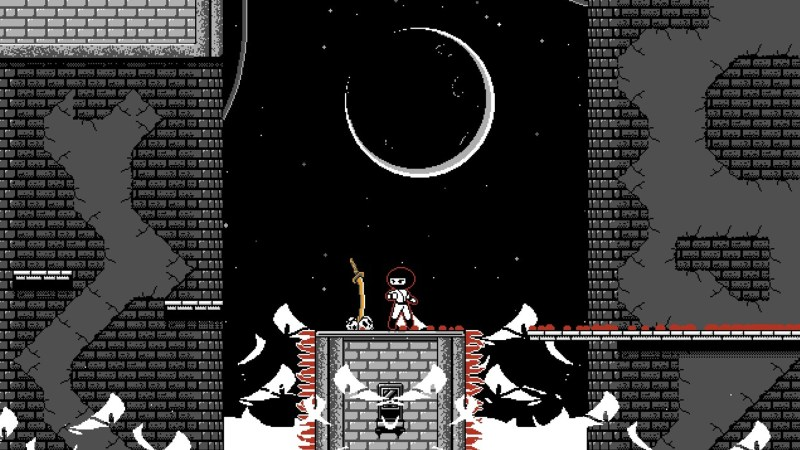 Screenshot of the first level showing the Ninja posed above dancing flames.