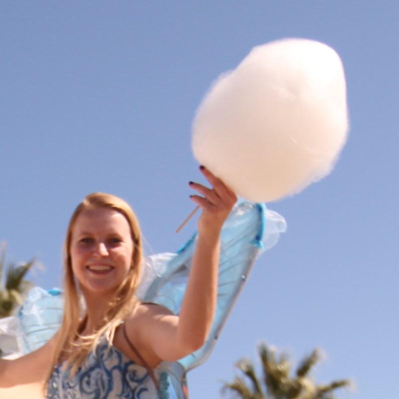 stilt walker fairy with cotton candy