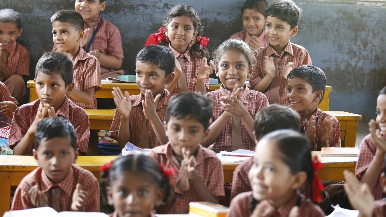 Young children learning foundational skills in a classroom