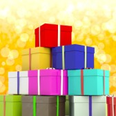 Multicolored Giftboxes  With Yellow Bokeh Background As Presents For The Family
