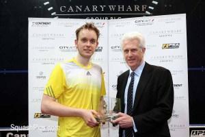 James receives winner's trophy from John Garwood