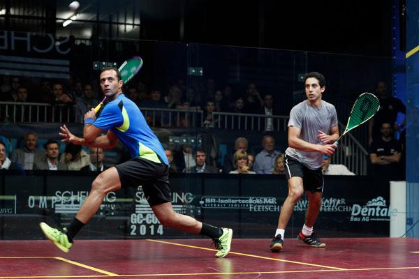 Amr Shabana (blue shirt) hunts the ball down against tarek Momen