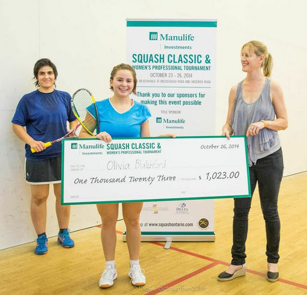 Olivia Blatchford receives the winner's cheque