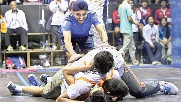 Saurav Ghosal is mobbed on court