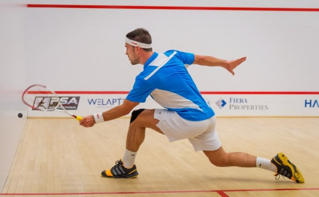 Quality control from Peter Barker as he stretches into a forehand