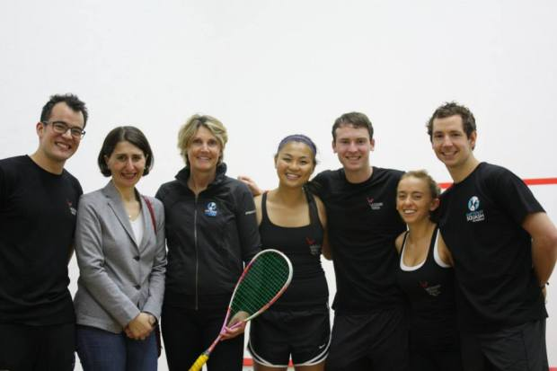 Aaron Frankcomb on court with former world champion Michelle Martin (second left) and some happy juniors