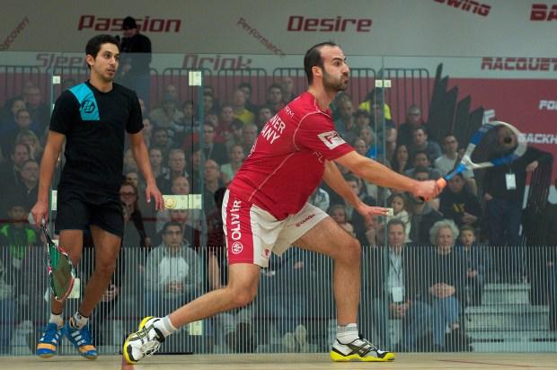 Simon Rosner attacks with a volley against Tarek Momen