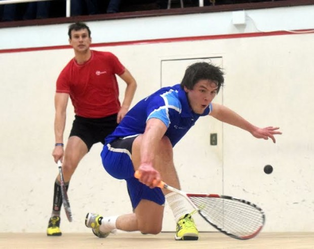 Dougie Kempsell plays a drop shot against Phil Nightingale