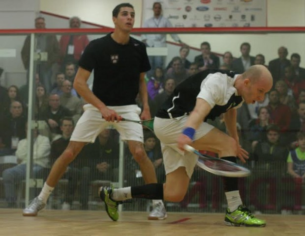 Olli Tuominen (right) keeps it tight on the backhand against Ali Farag