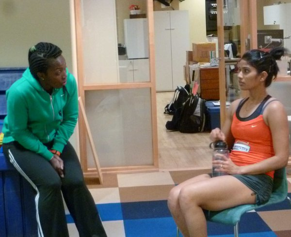 Joshna Chinappa gets some advice from Siyoli Waters