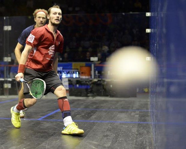 Gregory Gaultier fires in a tight backhand against Steve Coppinger