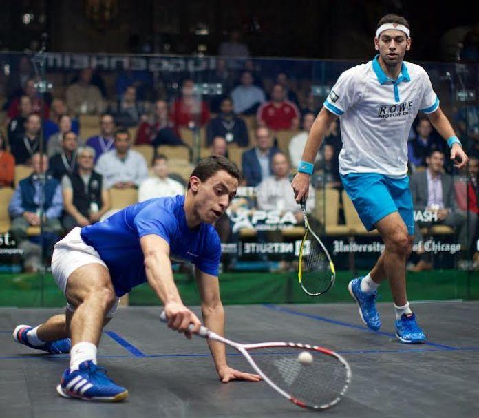 Fares Dessouki stretches for the ball against Mohamed Elshorbagy