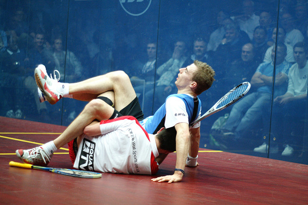 The crowd are up close as Nick takes a tumble with Daryl Selby in 2011