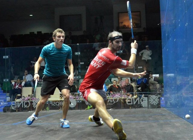 Watching the spot where the ball bounces on the floor, Simon Rosner sets up his big backhand